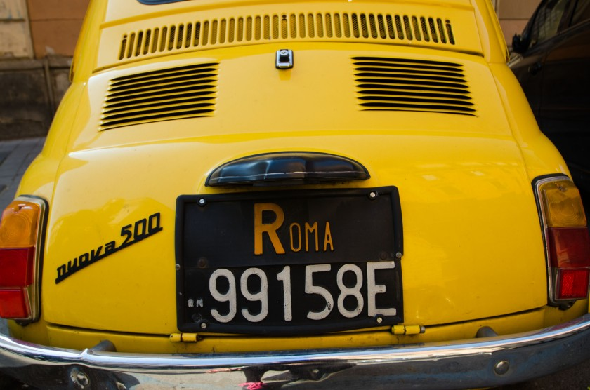 Yellow Fiat 500 in Rome